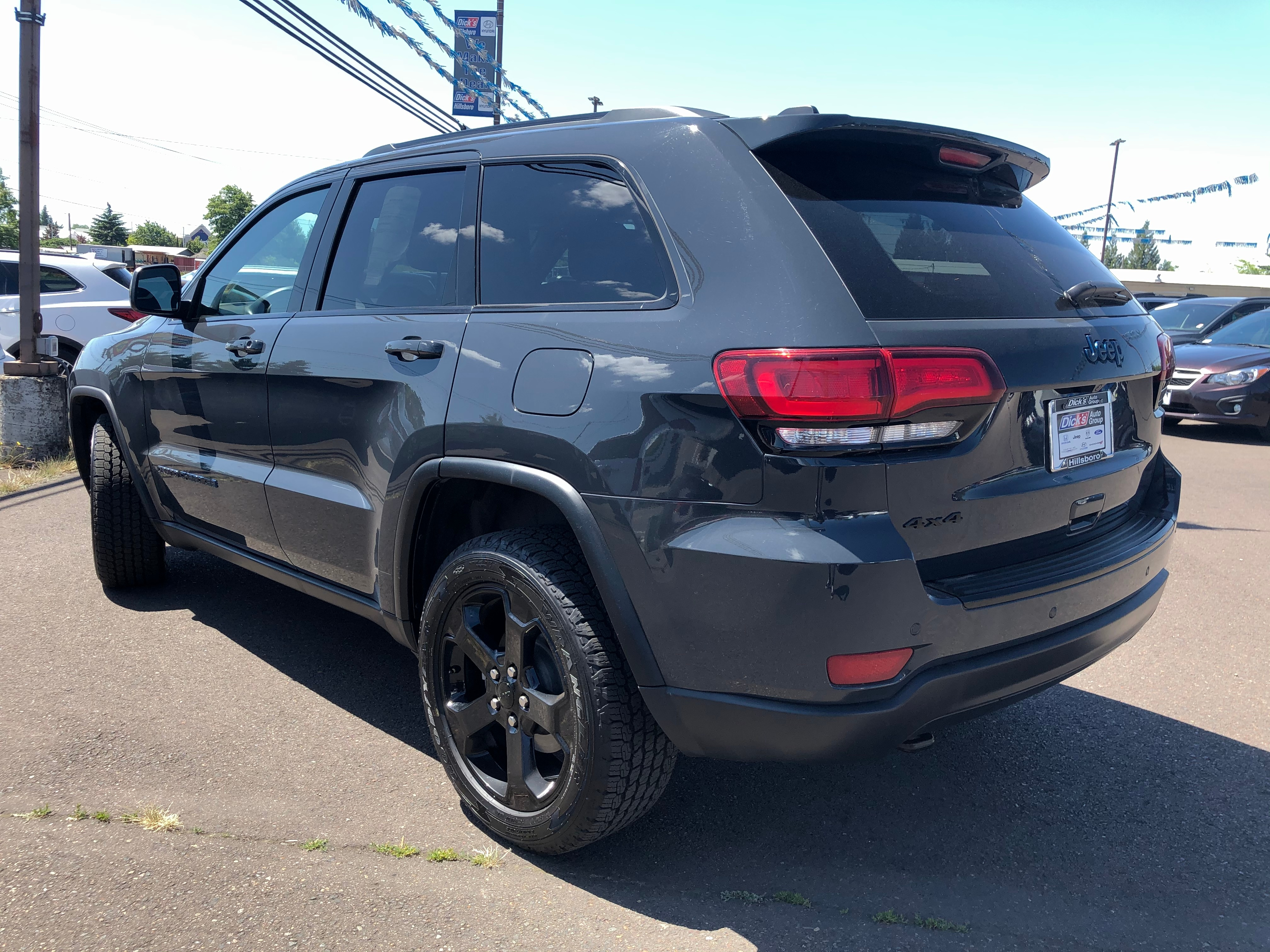 Pre-Owned 2018 Jeep Grand Cherokee Laredo 4x4